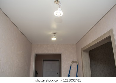 installation of spotlights on a stretch vinyl white ceiling