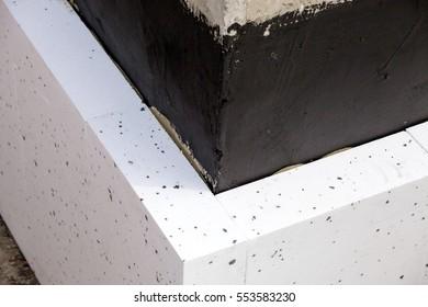 Installation of the Styrofoam walls of a building foundation