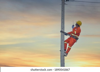 Installation of switching and connecting overhead electrical lines on a pole. An electrician is working on a pole.Linemen. - Shutterstock ID 1890541867