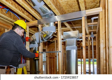 Installation system HVAC duct ventilation pipes in silver insulation of central conditioning a wall