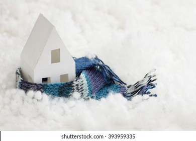 installation with winter background with a house wrapped in warm scarf