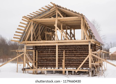 Installation of wooden beams at construction of the frame house. winter/snow.