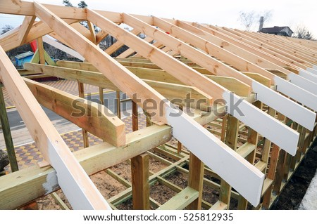 installation of wooden beams at construction the roof truss system of the house - How To Build Roof Trusses