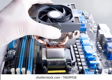 installing black cooler fan with copper tubes on computer processor