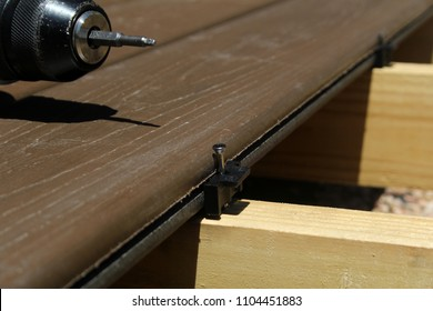 installing composite deck boards with hidden decking clips