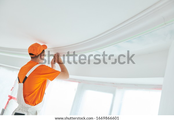 installing decorative ceiling molding. home repair and decoration