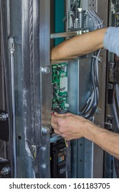 Installing elevator control panel, elevator parts installation