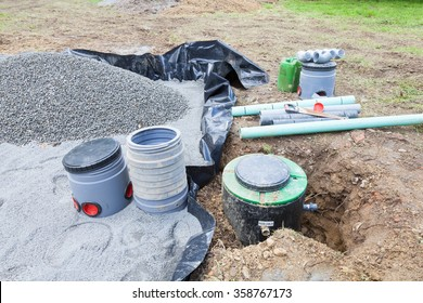 Installing the gravel filter bed and pump for a septic tank sanitation system for a residential house for the disposal of wastewater and sewage