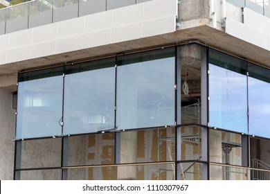 Installing large size glass windows to a multi commercial office building.