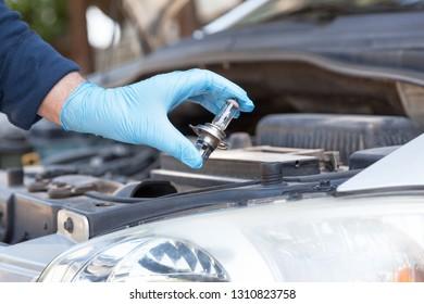 Installing new car headlight bulb