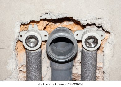 Installing pipes for water supply, heating, sanitation. Workplace plumbing in construction. Installing plumbing