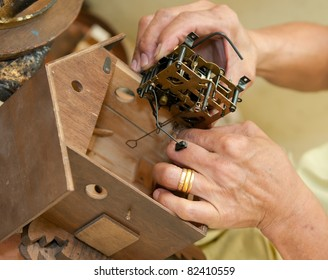 Installing the primary mechanism block in the interior of a cuckoo clock