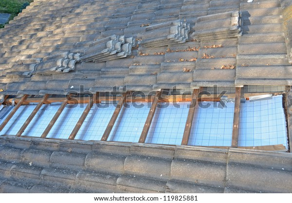 Installing Roof Insulation Home Reduce Heat Stock Photo