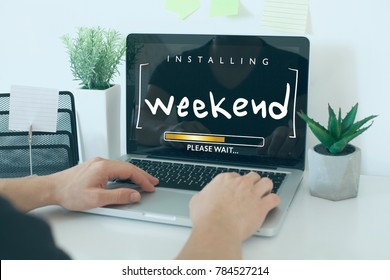 Installing weekend please wait note concept / Hands on laptop in office