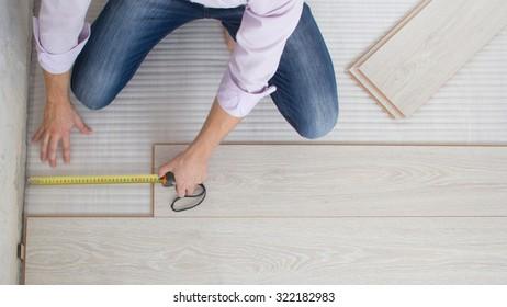 Installing wooden laminate flooring