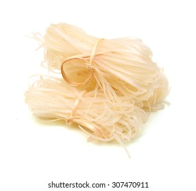 Instant asian style dried brown rice noodles isolated on white background
