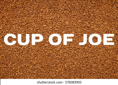 Instant coffee granules background with CUP OF JOE concept text