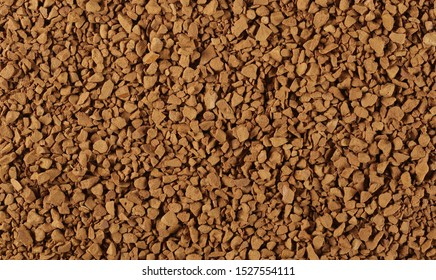 Instant coffee granules background and texture
