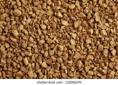 Instant coffee granules on white plate