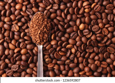 instant coffee in a spoon and coffee beans. Coffee, coffee drinks.