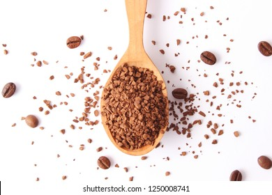 instant coffee in a spoon and coffee beans isolated on white. Aromatic coffee, coffee drinks