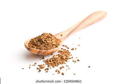 The instant coffee in spoon isolated on white background.