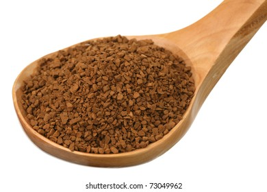 Instant coffee in a wooden spoon on a white background