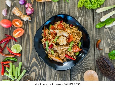 Instant noodle  salad  with seafood and vegetable. It is spicy and very hot but yummy. This is clever menu. Easy cook and fast. Instant noodle can do for easy dinner and good meal.