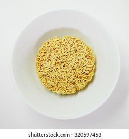 Instant noodle in white bowl that ready to cook.