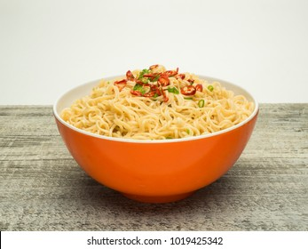 instant noodles in the bowl on wooden background.