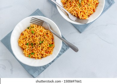 Instant Noodles in the Bowls Top Down Photo on White Background.