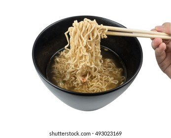 Instant noodles with chopsticks on isolated white background