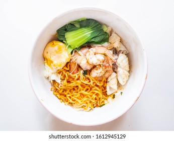 Instant Noodles with egg and shrimp,vetgetable,squid in the Bowls Top Down Photo on White Background.