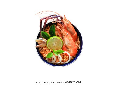 The instant noodles isolated on white background, with clipping path, Tom Yum Goong Food, Lobster shrimp (giant freshwater prawn) and herbs, spices, lemon, various vegetables.