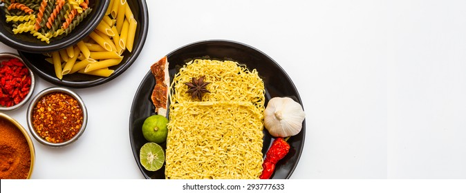 Instant noodles and pasta for cooking in the dish on white background.(Top view and copy space)