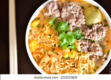 Instant noodles with pork and egg, fast food.