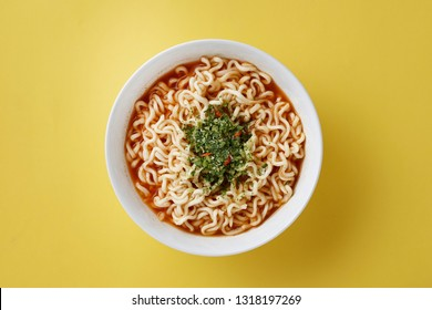 Instant noodles with toppings in bowl,  Instant noodles in soup isolated on yellow background