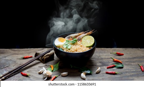 instant noodles in wooden bowl.selective focus. Asian food on a table, junk food concept
