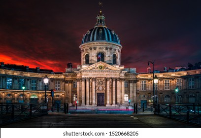 Institut de France in Paris after sunset with city lights