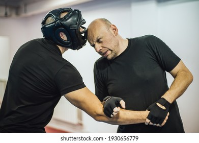 Instructor demonstrate headbutt street fight technique against attacker. Head kick. Martial arts practice