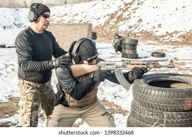 Instructor had firearm tactical shooting training with group of students on outdoor shooting range. Winter and snow cold season