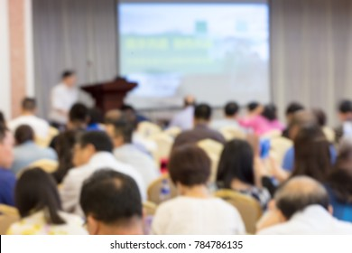 Instructor teaching in China, blurred background