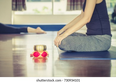 Instructor with yoga class at in door gym
