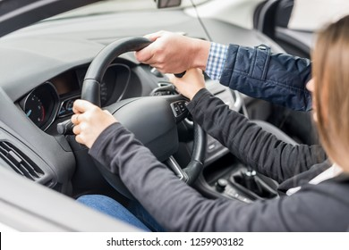 Instructor's hand helping drive to a woman