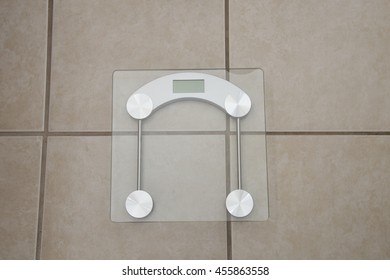 Instrument for measuring pounds or kilograms /Digital WeightDevice/Glass scale on tile surface