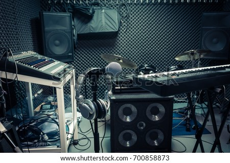 instrument for musician or producer concept background. Selective focus of microphone with essential items music band at home recording studio.Mix equipment for rock or classic musical background.