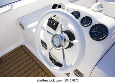 Instrument panel and steering wheel of a motor boat cockpit (yacht control bridge)