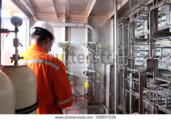 Instrument technician on the job calibrate or function check Pressure transmitter in oil and gas process. Pressure transmitter, send signal to controller and reading pressure in the system.