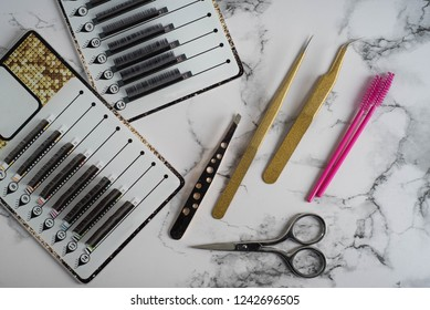 Instruments: Beauty and fashion concept - Eyelash Extension Procedure. Tools for eyelash extension. False eye lashes, glue, tweezers