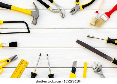 instruments of constructor for build, paint and repair house on white wooden background top view mockup